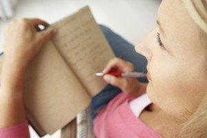 Anxious woman using journal